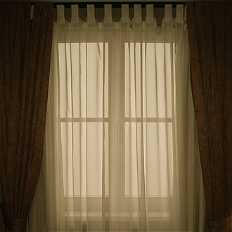 Curtain - Translucent curtains hung on a window.