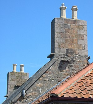 Witches' stones on tiled roof Jersey 3.jpg