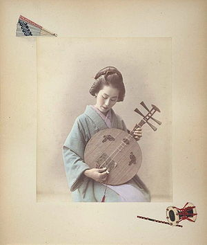 Adolfo Farsari - Woman playing a gekkin, c. 1886. Hand-coloured albumen print on a decorated album page.