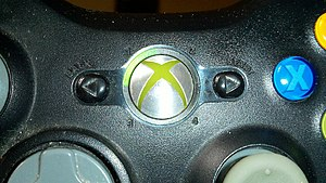 Xbox 360 controller - Xbox 360 guide button.
