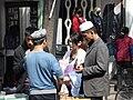 Xinhui 新會城 大新路 Daxin Lu Street vendors 02 men with hats.JPG