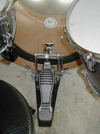 A Yamaha bass drum pedal on a Tama drum set.