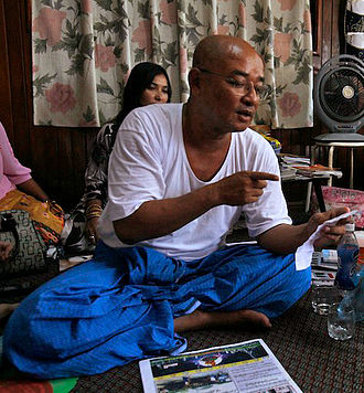 Zarganar - Zaganar, Myanmar famous political comedian, reads letter as he wrote in prison for his friends at his home after he was released by government's amnesty, Yangon, Myanmar 13 October 2011.
