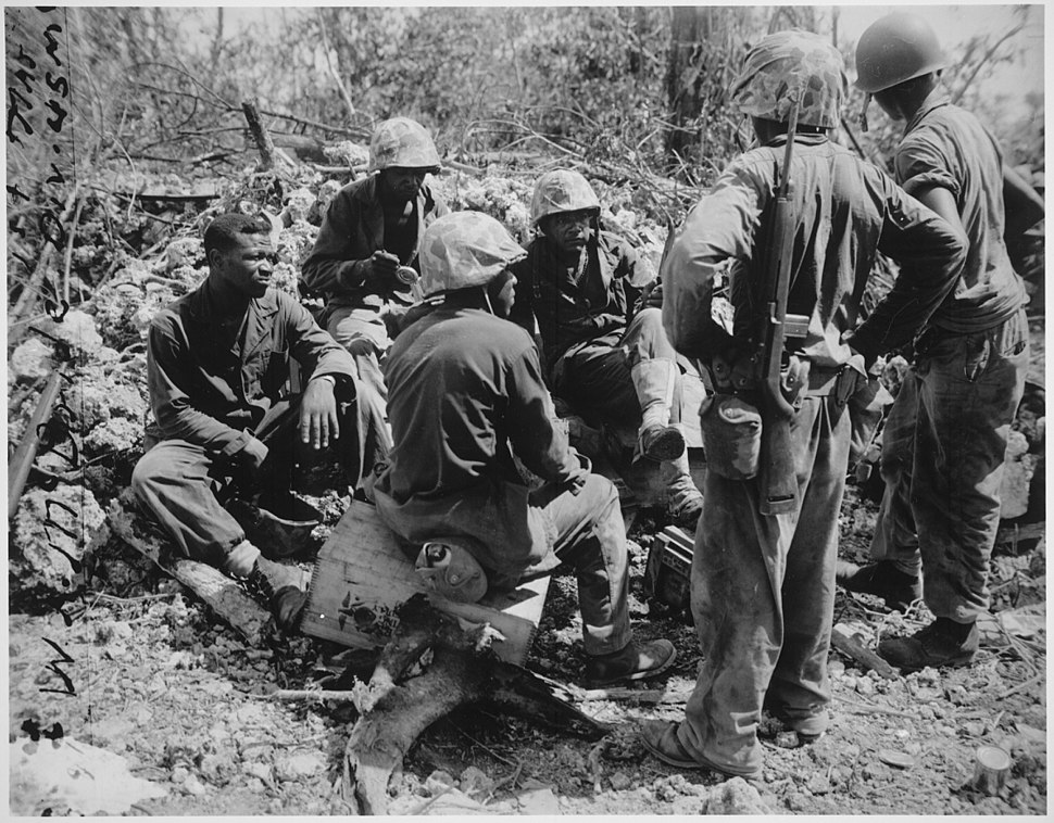 """Group of CBs acting as stretcher bearers for the 7th Marines. Peleliu."", 09-1944 - NARA - 532537"