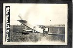 """The Crash of L Brooks."" Several people in and around Curtiss JN-4 aircraft C428. (8513997202).jpg"