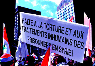 "Human rights in Syria - Demonstration in Montreal in solidarity with the people of Syria. The sign reads: ""Stop torture and inhumane treatment of prisoners in Syria!"""