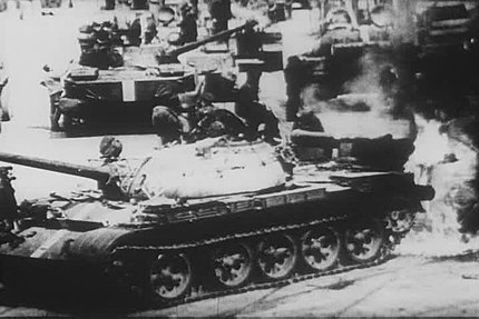 A Soviet T-55 tank catches fire while battling Czech protesters during the 1968 invasion of Czechoslovakia. (Srpen68)Horici sovetsky tank.jpg