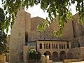 042 Monestir de Sant Feliu, façana oest, amb la Porta Ferrada.jpg