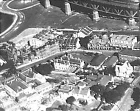 Aerial view of the Jeffrey Street area showing cottages, terraces and part of the Sydney Harbour Bridge