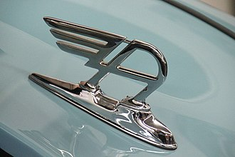 "Austin Motor Company - The ""winged-A"" at the front of the bonnet/hood of new mainstream Austin models  between 1947 and 1956 recalled the ""flying-B"" on post-war Bentley models"