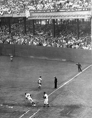 1954 World Series - Dusty Rhodes of the New York Giants rounds the bases after hitting a home run during the seventh inning of the second game of the 1954 World Series.