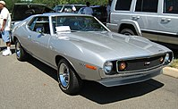 "Shows a silver 1971 AMC Javelin AMX - the performance model with ""flush"" wire-mesh grille"