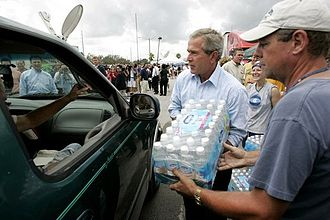 Hurricane Frances - President George W. Bush helps deliver water at a relief center in Ft. Pierce, Florida.