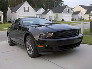 black 2011 Ford Mustang v6 Coupe with the optional Performance package