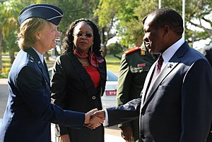 Aires Ali - Aires Ali (right) greets U.S. Air Force Maj. Gen. Barbara Faulkenberry at the start of an International Military HIV/AIDS Conference   in Maputo during May 2012