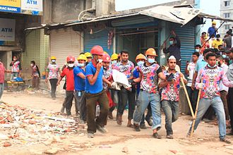 2013 Savar building collapse - Rescuers carrying out one of the survivors from the collapsed building
