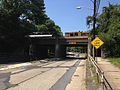 2014-08-27 13 02 41 View west along Parkway Avenue (Mercer County Route 634) near the Delaware and Bound Brook Railroad underpass, with concrete pavement likely dating to the 1950s.JPG