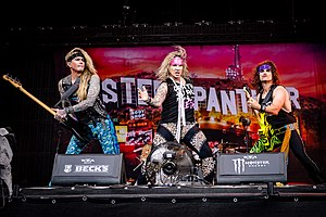 Steel Panther at Wacken Open Air 2018. Left to right: Lexxi Foxxx, Michael Starr and Satchel