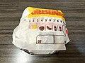 2019-02-28 21 42 53 A Burger King cheeseburger still in its wrapper in Oak Hill, Fairfax County, Virginia.jpg