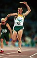 301000 - Athletics track 4 x 100m T38 relay Tim Sullivan gold finish - 3b - 2000 Sydney race photo.jpg