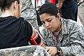 88th Medical Group medical technician checks vitals during August 4 2017 training exercise.jpg