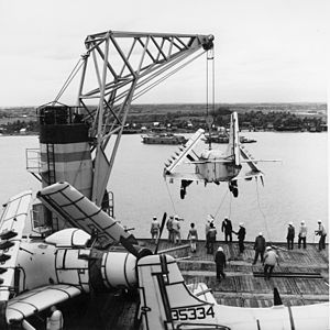 A-1G on crane of USNS Core (T-AKV-41) at Saigon c1965.jpg