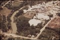 AERIAL VIEW OF DAMAGE CAUSED BY FLOODING OF GUADALUPE RIVER - NARA - 544471.tif