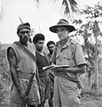 AWM 127566 Capt T. GRAHAMSLAW, ANGAU, BRIEFING SERGEANT-MAJOR KATUE Oct 1942.jpg