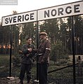 A Swedish soldier and Norwegian resistance member shake hands at the border, celebrating the end of German occupation in Norway, Värmland Hedmark, 7 May 1945. (49129129873).jpg