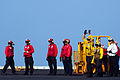 A U.S. Sailor, third from right, directs a Military Sealift Command SA-330J Puma helicopter, not pictured, to deliver cargo to the aircraft carrier USS George H.W. Bush (CVN 77) during a replenishment at sea 140827-N-CZ979-017.jpg