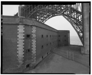 A general view of the northwest wall, in relation to the Fort Point arch of the golden gate bridge.