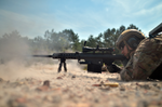 A member of of the 106th Security Forces Squadron. trains with a Barrett sniper rifle.png
