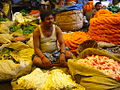 A seller at the Flower Market Calcutta.jpg