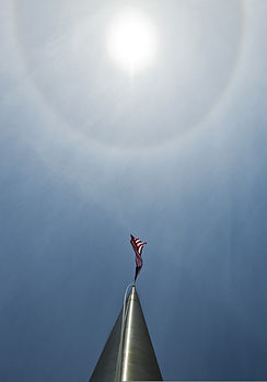A solar halo illuminates the sky over an American flag flying outside Building 1 at Eglin Air Force Base, Fla., in the early afternoon Nov. 12, 2013 131112-F-OC707-021.jpg