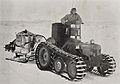A tractor towing a load of tractor fuel at Scott Base during the Commonwealth Trans-Antarctic Expedition, 1957.jpg