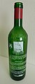 Achterzijde fles bordeauxwijn met illustratie 'Deerlijks drie groten' 02.jpg