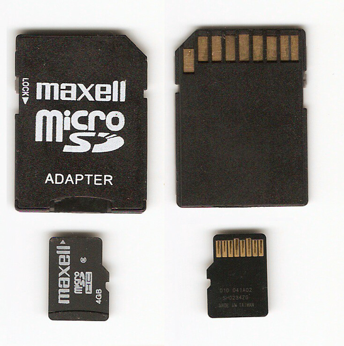 Picture of a MicroSD Card with its Adapter. Fr...
