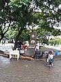 Adults who lives in the square of Vicente Matheus next to the monument.jpg