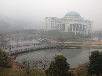 Zhejiang University of Technology - Aerial view of Campus Library and lagoon.