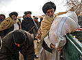 Afghan National Police-coalition specal operations forces food handout 120205-N-UD522-094.jpg