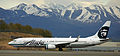 Alaska Air 737 with the Chugach Mountains in the background (6193703647).jpg