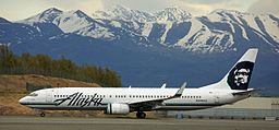 Alaska Air 737 with the Chugach Mountains in the background (6193703647)