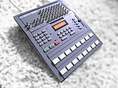 A photograph of the model of drum machine used on Streetcleaner against a carpet background