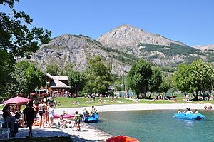 Allos - La Roche-Grande, dominating the recreational area.
