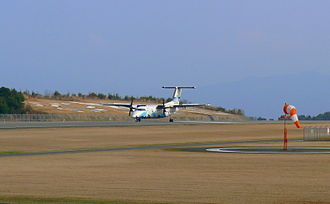 Amakusa - Amakusa Airfield, with DHC-8 plane on runway.