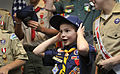 An 8-year-old Cub Scout reacts after receiving a Department of Defense baseball cap from Secretary of Defense Leon E. Panetta at the Pentagon Feb. 13, 2012 120213-D-NI589-144.jpg