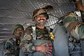 An Indian Army paratrooper smiles before jumping from a CH47 Chinook helicopter at Fort Bragg in 2013.jpg