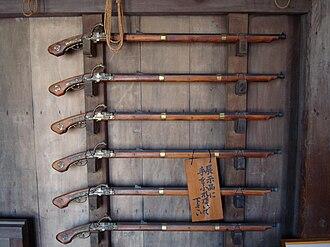 Firearms of Japan - A rack of Japanese tanegashima (matchlocks) of the Edo period, Himeji Castle, Japan.