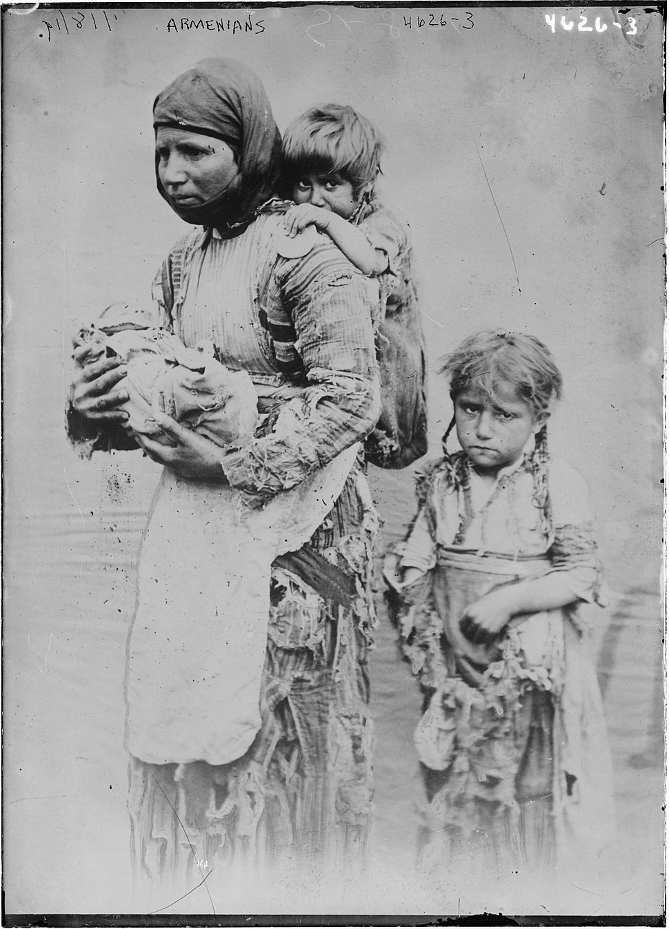 Armenian woman and her children from Geghi, 1899