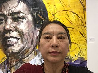 "Hung Liu - In front of her painting from her ""Daughters of China"" series"